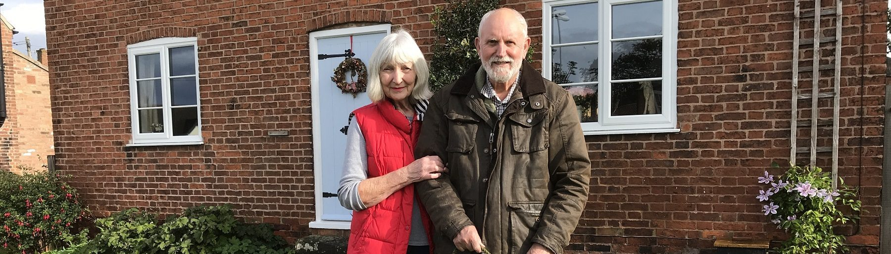 Picture of patient and his partner outside their home
